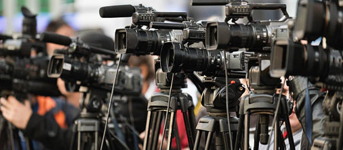 TV cameras lined up, covering large public event
